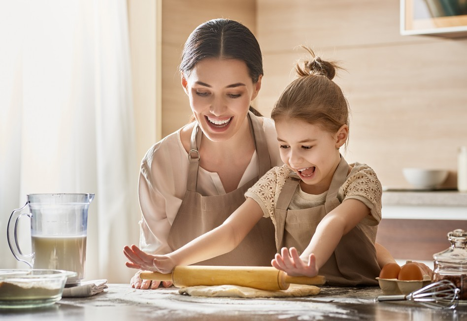 Mom spend s time with cooking with child